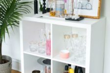 19 a stylish home bar made of an IKEA Kallax shelf with elegant gilded legs will fit many modern spaces