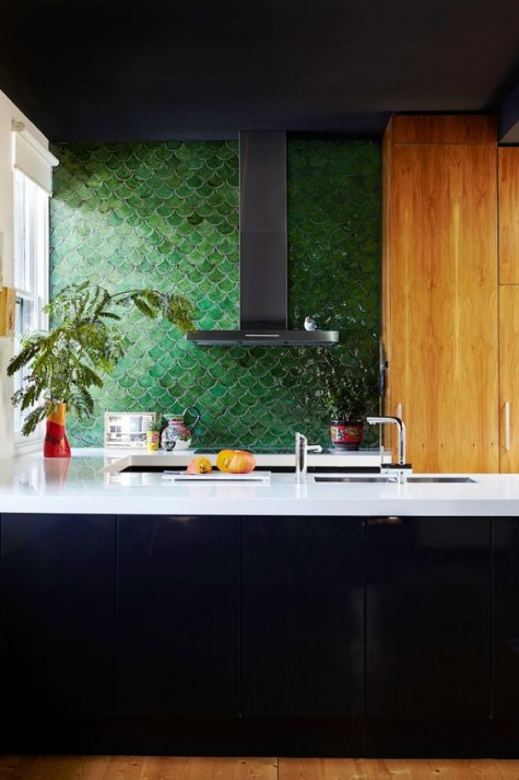 add a colorful accent to your moody monochromatic kitchen with a green fishscale tile backsplash
