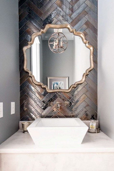 copper and silver shiny tiles clad in a chevron pattern will make your sink space very statement like