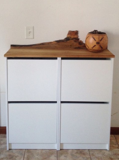IKEA Bissa hack with a wooden living edge countertop, which is a trendy and edgy idea to go for