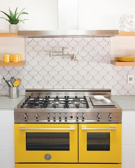 a bright and fun kitchen with touches of sunny yellow and fishscale tiles on the backsplash