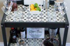 20 a stylish monochromatic bar made of an IKEA Sniglar changing table spruced up with mosaic tiles