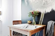 21 a small dining space with an oversized photograph that creates a mood