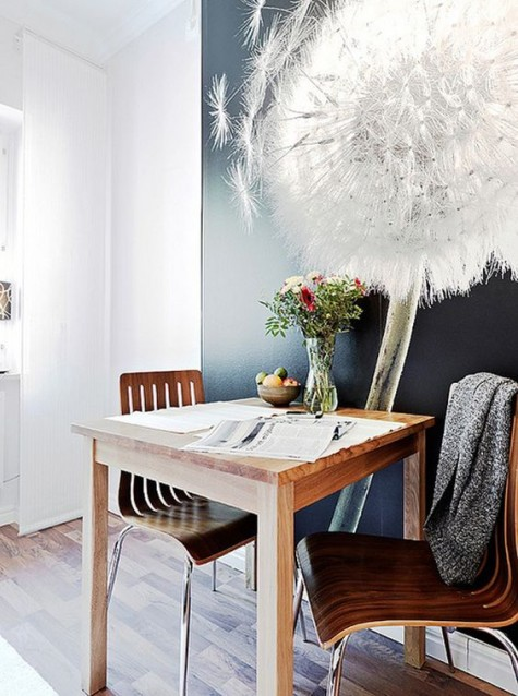 a small dining space with an oversized photograph that creates a mood