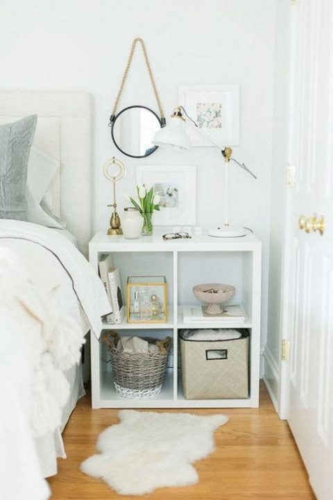 an IKEA Kallax shelf used as a stylish nightstand with much open storage space for a contemporary room