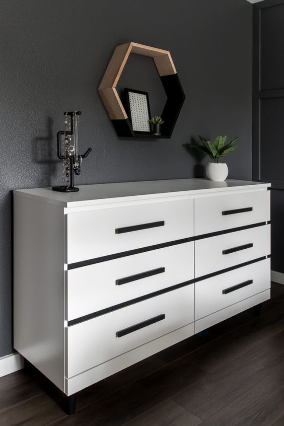 an IKEA Malm dresser made floating and with black stripes and handles attached to make it look dramatic