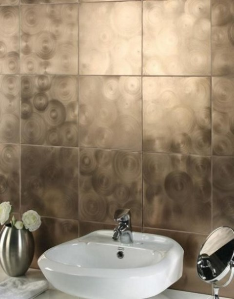 modern metallic tiles with a circular pattern will change your bathroom and give it a bold look
