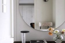22 a small yet trendy entryway with an oversized mirror and a bench – who needs more