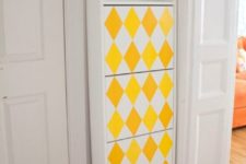 22 an IKEA Bissa hack done with legs, an open compartment and bright yellow geometric decals
