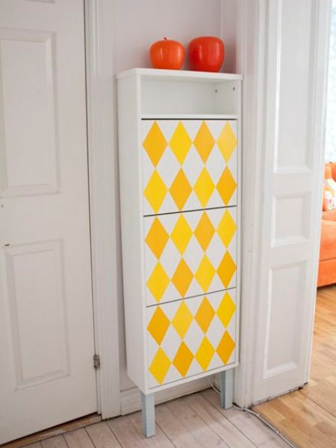 an IKEA Bissa hack done with legs, an open compartment and bright yellow geometric decals