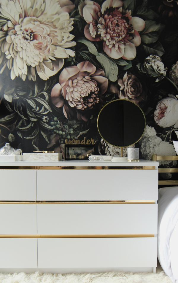 an IKEA Malm dresser hacked with gold vinyl above each handle is a stylish minimal and glam idea