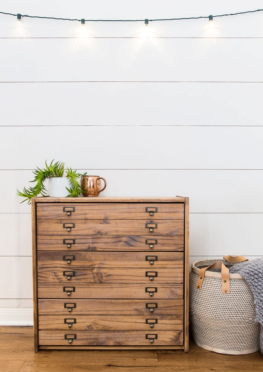 an IKEA Rast dresser with library pulls and a faux drawer front for a retro feel in your space