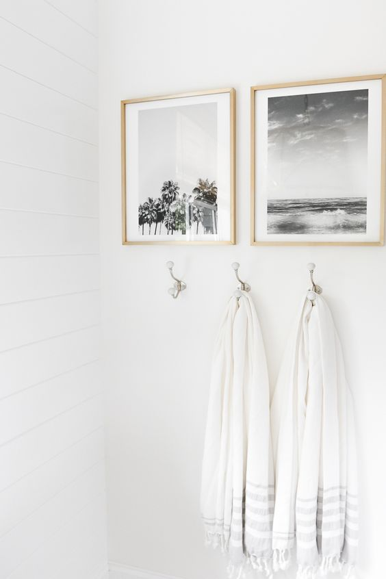 black and white coastal-inspired artworks in light-colored frames will spruce up any monochromatic or neutral space