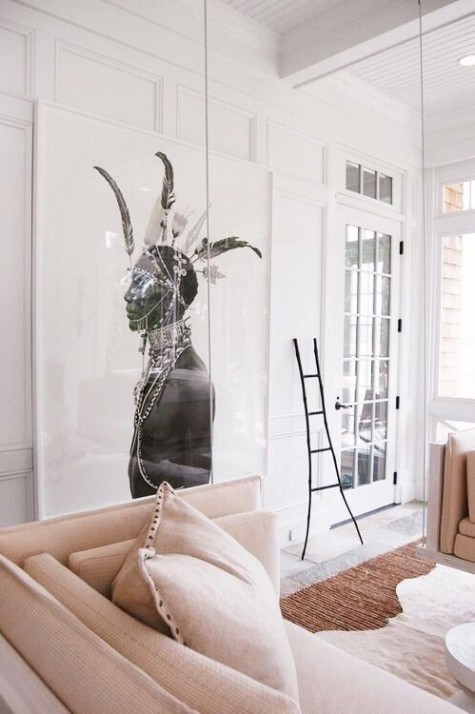 a small sunroom with an oversized artwork that takes over the whole space creating a mood