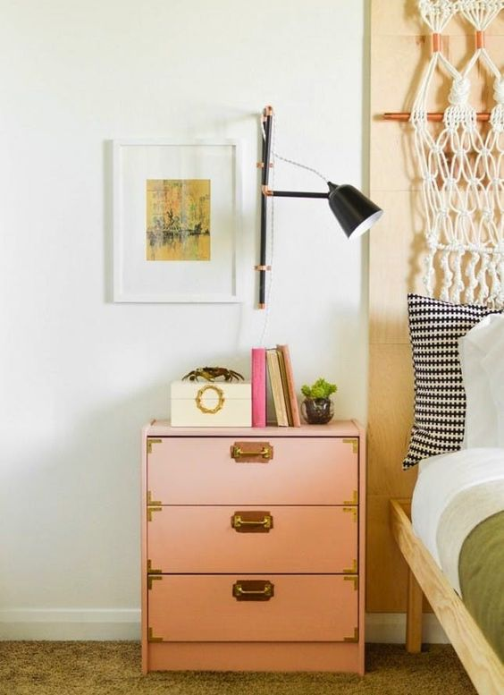 an IKEA Rast dresser hack in pink, with gold handles and trim looks bright and fits a modern space