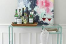 23 an IKEA Vittsjo desk hack into a stylish and contemporary home bar that doesn't look bulky