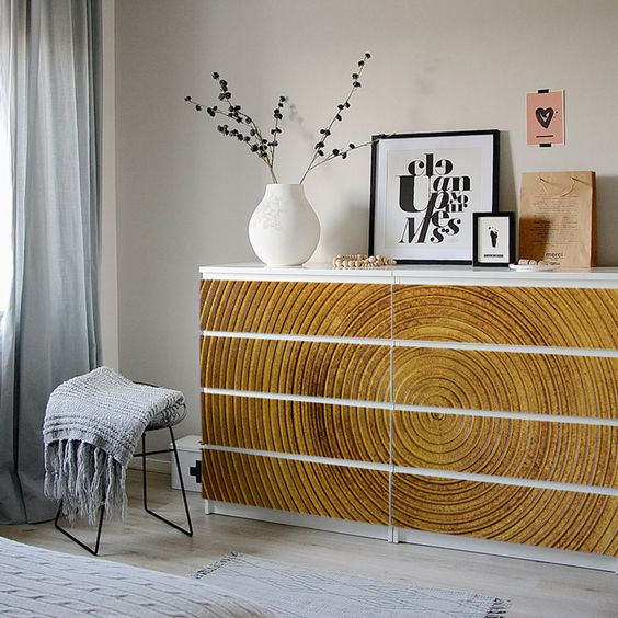 IKEA Malm dresser hack with gorgeous wood imitating stickers that add texture and structure to the space