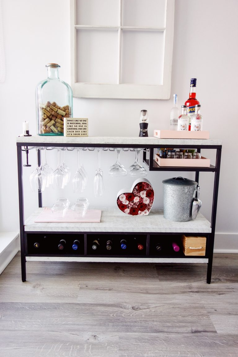 an IKEA Vittsjo desk hack with contact paper and paints into a large and stylish home bar