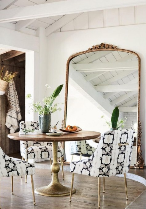 spruce up your small dining room with an oversized mirror in a refined frame