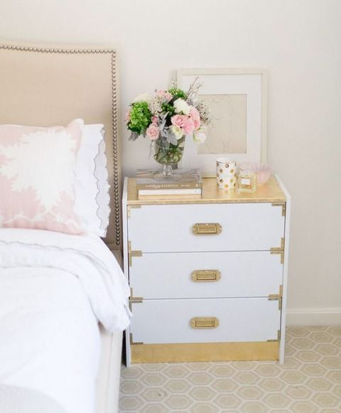 an IKEA Rast hack in glam style in white and gold is a cool nightstand for a bedroom in glam style