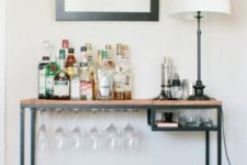 25 an IKEA Vittsjo hack into a rustic home bar with plenty of storage space for glasses and wine bottles