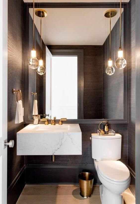 maximize the size of your mirror in a tiny powder room and you'll love the effect