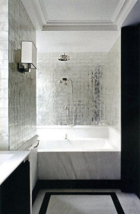 silver square tiles will add a touch of glam to your shower and stand out in the contrasting space