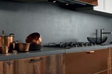 a bold kitchen with white and rich wood cabinets, copper touches and a concrete backsplash and countertops