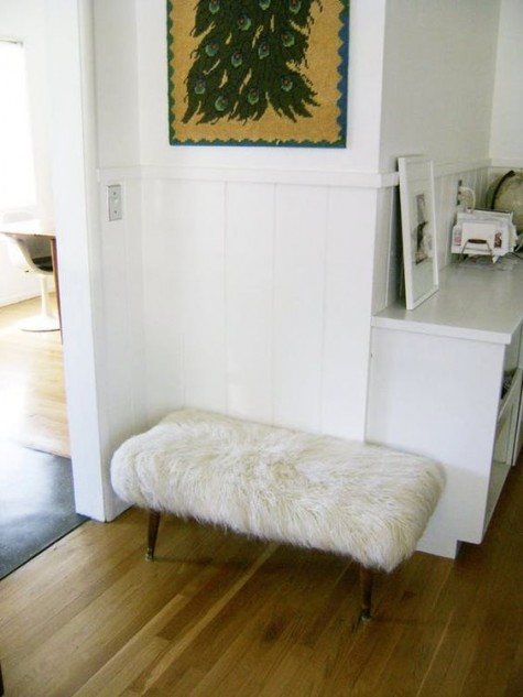 a comfy furry ottoman made of a bench and an IKEA faux fur rug in white is a cool glam idea