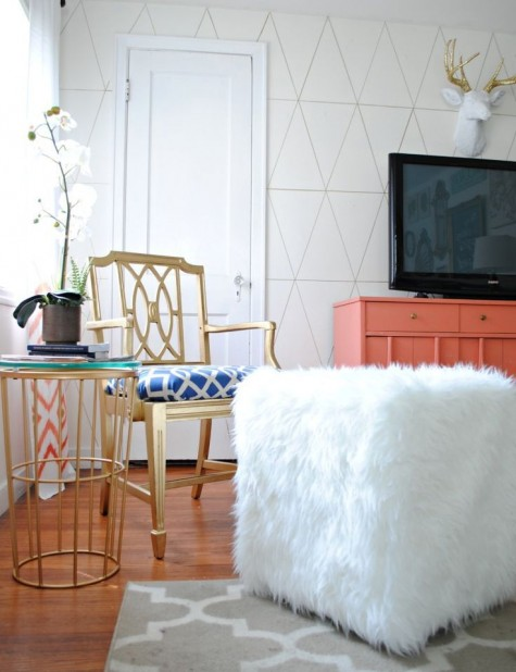 a glam ottoman made of a plywood cube and covered with an IKEA Tejn faux fur skin for a glam space