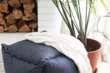a gorgeous navy modern ottoman made of IKEA Fjadrar cushion inserts and Ormkaktus fabric