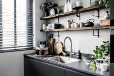 a grey concrete backsplash and countertop plus raw edge wooden shelving add texture here