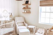 a neutral farmhouse nursery with wooden furniture and woven shades and lamps plus printed rugs