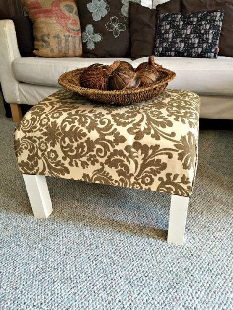 a plain and old IKEA Lack end table turned into a stylish ottoman with bright printed fabric