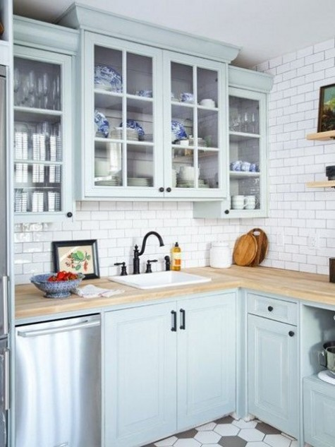 a powder blue vintage-inspired kitchen with light-colored butcher block countertops