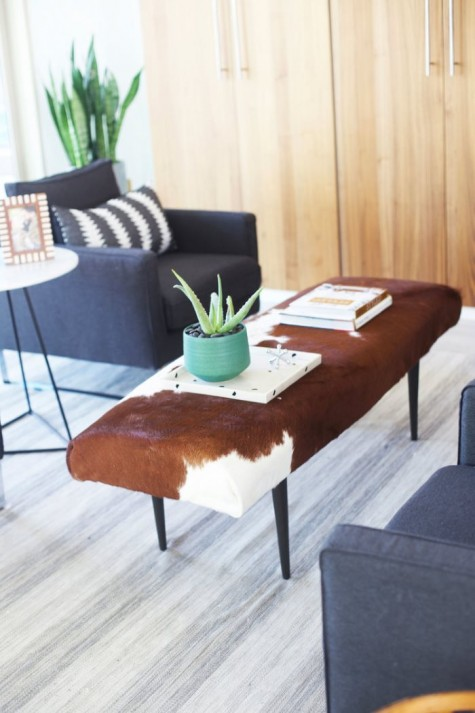 a stylish ottoman reupholstered with an IKEA Koldby Cowhide for mid century modern space