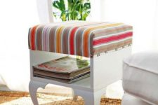 a vintage ottoman with storage made of an IKEA Trollsta side table and bright striped fabric