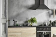 an IKEA Askersund kitchen with a whole concrete wall, not only a backsplash looks spectacular