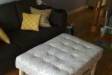 an IKEA Hemnes coffee table renovated into a stylish and simple upholstered ottoman