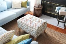 an IKEA Karlstad footstool renovated with printed fabric looks like a nice fit for a mid-century modern space