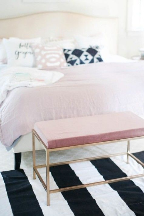 an IKEA Vittsjo table changed into a cool ottoman with a pink cushion and gold spray paint