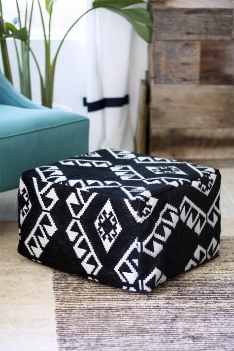 an IKEA footstool turned into a comfy boho folksy pouf in black and white with patterns