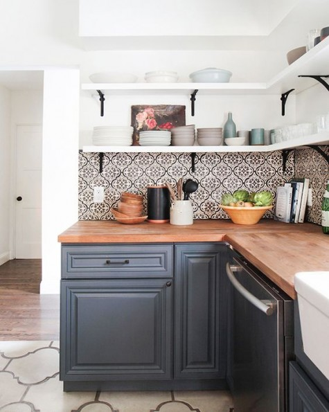 grey cabinets, mosaic tiles and light-colored butcher block countertops for a wow look