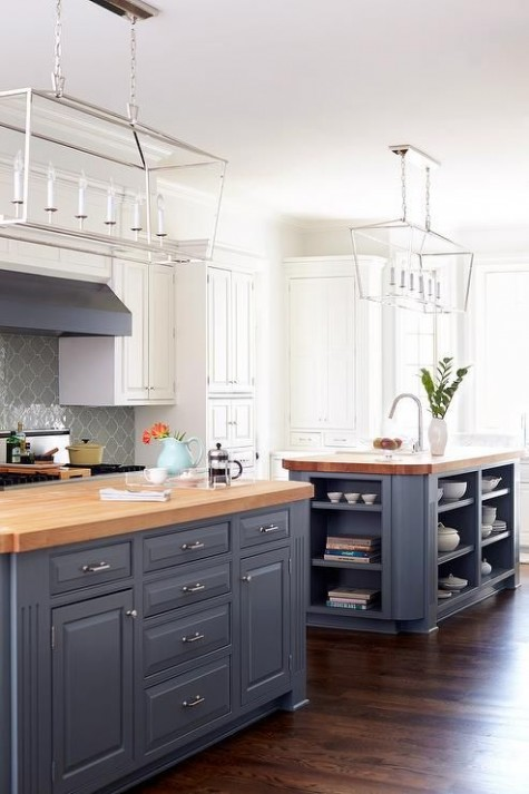 vintage-inspired grey cabinets are softened with light-colored butcher block countertops