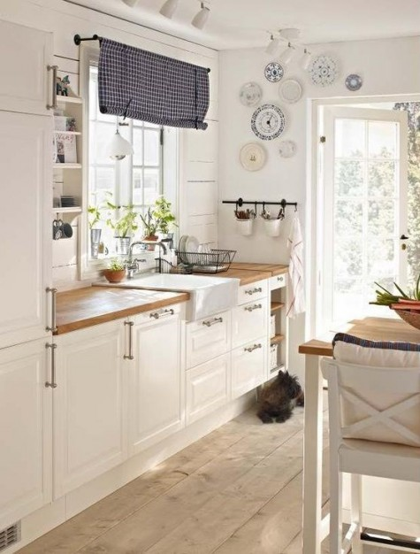 vintage white cabinets with light-colored butcher block countertops for a cozy feel and touches of blue