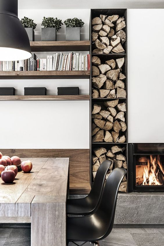 a built-in fireplace and built-in firewood storage next to it to add a warm and a bit rustic feel to the space