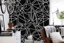 02 a statement black geometric wall adds catchiness to the Scandinavian space and makes it super modern and bold