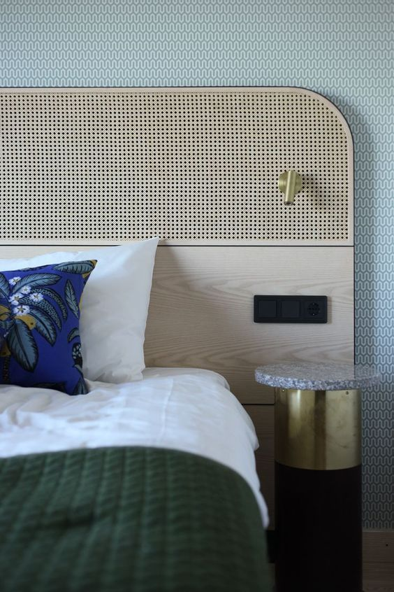 a catchy and comfy plywood and cane headboard with additional lights on it is perfect