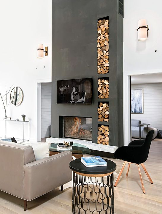 a contemporary living room finished off with a concrete clad fireplace and built-in firewood storage in the same unit