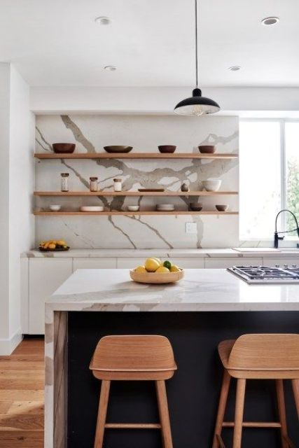 a contemporary white and black kitchen with white marble countertops and a backsplash plus open shelving is wow